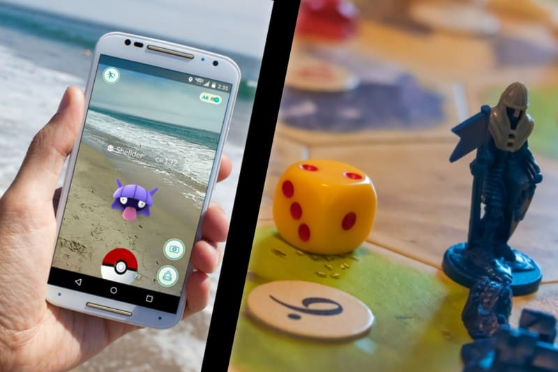 This Picture Is Broken Up Into Two Parts. The Left Side There Is A Hand Holding A Smartphone, Trying To Catch A Pokemon. You Can See There Is Ocean In The Background. On The Right Side Of The Picture, There Are Some Dice And Tokens On A Catan Board Game.